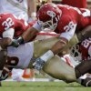 Oklahoma\'s Jamell Fleming (32) Travis Lewis (28) and Quinton Carter (20) bring down Florida State\'s Beau Reliford (88) during the first half of the college football game between the University of Oklahoma Sooners (OU) and the Florida State University Seminoles (FSU) on Sat., Sept. 11, 2010, in Norman, Okla. Photo by Chris Landsberger, The Oklahoman