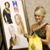 Photo - INDUCT / INDUCTED / INDUCTION / INDUCTEE: Carrie Underwood smiles after signing a painting during a press conference for her induction into Oklahoma Music Hall of Fame in Muskogee, Okla., Thursday, September 17, 2009. Photo by Bryan Terry, The Oklahoman ORG XMIT: KOD