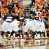 The Oklahoma State Cowboys get pumped up before the start of their exhibition game versus Campbellsville on Oct. 27, 2013 at Gallagher Iba Arena in Stillwater, Okla. The Cowboys won 80-70, lead by Markel Brown\'s 13 points. Photo by KT King/For the Oklahoman