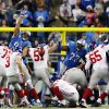 Photo - New York Giants kicker Josh Brown (3) kicks a 45-yard field goal during the overtime period of an NFL football game against the Detroit Lions in Detroit, Sunday, Dec. 22, 2013. The Giants won 23-20. (AP Photo/Paul Sancya)