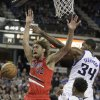 Photo - Portland Trail Blazers center Robin Lopez, left, loses the ball after it was hit out of his hands by Sacramento Kings forward Jason Thompson, right, during the first quarter of an NBA basketball game in Sacramento, Calif., Tuesday, Jan. 7, 2014. (AP Photo/Rich Pedroncelli)