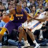 Oklahoma City\'s James Harden (13) takes a charge form Lakers\' Kobe Bryant (24) during the NBA basketball game between the Oklahoma City Thunder and the Los Angeles Lakers, Sunday, Feb. 27, 2011, at the Oklahoma City Arena.Photo by Sarah Phipps, The Oklahoman