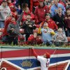 St. Louis Cardinals center fielder Jon Jay climbs the outfield wall looking for a two-run home run hit by Milwaukee Brewers\' Mark Reynolds during the second inning of a baseball game Wednesday, April 30, 2014, in St. Louis. (AP Photo/Jeff Roberson)