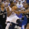 Oklahoma City\'s Kevin Durant (35) goes between San Antonio\'s Tony Parker (9) and Kawhi Leonard during Game 4 of the Western Conference Finals between the Oklahoma City Thunder and the San Antonio Spurs in the NBA playoffs at the Chesapeake Energy Arena in Oklahoma City, Saturday, June 2, 2012. Oklahoma CIty won 109-103. Photo by Bryan Terry, The Oklahoman