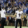 Photo - Baltimore Ravens kicker Justin Tucker (9) and place holder Sam Koch (4) watch as Tucker's 61-yard field goal clears the uprights during the fourth quarter of an NFL football game against the Detroit Lions in Detroit, Monday, Dec. 16, 2013. (AP Photo/Duane Burleson)