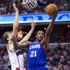 Photo - Philadelphia 76ers forward Thaddeus Young (21) scores past Washington Wizards forward Jan Vesely during the first half of an NBA basketball game on Monday, Jan. 20, 2014 in Washington.  (AP Photo/ Evan Vucci)