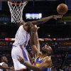 Oklahoma City\'s Serge Ibaka (9) blocks the shot of Golden State\'s Carl Landry (7) during an NBA basketball game between the Oklahoma City Thunder and the Golden State Warriors at Chesapeake Energy Arena in Oklahoma City, Wednesday, Feb. 6, 2013. Photo by Bryan Terry, The Oklahoman