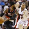 Photo - Portland Trail Blazers guard Mo Williams, left, looks for an open teammate past Miami Heat forward Shane Battier (31) during the first half of an NBA basketball game, Monday, March 24, 2014 in Miami. (AP Photo/Wilfredo Lee)