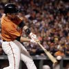 Photo - San Francisco Giants' Buster Posey drives in a run with a single against the Milwaukee Brewers during the second inning of a baseball game on Friday, Aug. 29, 2014, in San Francisco. (AP Photo/Marcio Jose Sanchez)