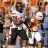 Oklahoma State\'s Jeremy Smith (31) breaks away from Texas\' Quandre Diggs (28) on a long touchdown run in the third quarter during a college football game between the Oklahoma State University Cowboys (OSU) and the University of Texas Longhorns (UT) at Darrell K Royal-Texas Memorial Stadium in Austin, Texas, Saturday, Oct. 15, 2011. OSU won, 38-26. Photo by Nate Billings, The Oklahoman