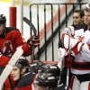 Photo - New Jersey Devils goalie Martin Brodeur, right, stands at the bench with members of the Albany Devils, the team's AHL farm team, during a scrimmage on Wednesday, Jan. 16, 2013, in Newark, N.J. (AP Photo/Julio Cortez)