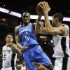 Oklahoma City Thunder\'s Serge Ibaka (9), of Congo, falls as he chases the ball between San Antonio Spurs\' Tim Duncan, right, Boris Diaw, bottom, of France, and Cory Joseph during the second half of an NBA basketball game, Monday, March 11, 2013, in San Antonio. San Antonio won 105-93. (AP Photo/Darren Abate) ORG XMIT: TXDA107