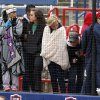 Washington fans bundle up against the cold during the class 3A Girl\'s State Softball playoffs at the ASA Hall of Fame Stadium in Oklahoma City, OK, Friday, October 5, 2012, By Paul Hellstern, The Oklahoman