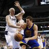 Dallas Mavericks center Chris Kaman (35) guards against a bounce pass by Golden State Warriors\' David Lee (10) in the first half of an NBA basketball game, Monday, Nov. 19, 2012, in Dallas. (AP Photo/Tony Gutierrez)