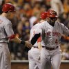 Cincinnati Reds\' Brandon Phillips, right, gets congratulated by Drew Stubbs after Phillips hit a two-run home run in the third inning of Game 1 of the National League division baseball series against the San Francisco Giants in San Francisco, Saturday, Oct. 6, 2012. (AP Photo/Eric Risberg)