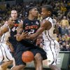 Missouri\'s Kim English, right, knocks the ball away from Oklahoma State\'s Le\'Bryan Nash (2) as Missouri\'s Matt Pressey, left, and Oklahoma State\'s Philip Jurick (44) look on during the first half of an NCAA college basketball game Wednesday, Feb. 15, 2012, in Columbia, Mo. (AP Photo/L.G. Patterson) ORG XMIT: MOLG102