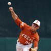Photo - Texas' Nathan Thornhill delivers a pitch during the first inning of an NCAA college baseball regional game against Texas A&M, Friday, May 30, 2014, in Houston. (AP Photo/Houston Chronicle, Eric Christian Smith)