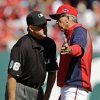 Washington Nationals manager Davey Johnson, right, protests a call with first base umpire Jim Joyce after Washington\'s Danny Espinosa was called out at first base in the first inning of Game 3 of the National League division baseball series on Wednesday, Oct. 10, 2012, in Washington. (AP Photo/Alex Brandon)