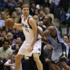 Photo - Dallas Mavericks power forward Dirk Nowitzki (41), of Germany, dribbles against Memphis Grizzlies power forward Zach Randolph (50) during the first half of an NBA basketball game on Saturday, Jan. 12, 2013, in Dallas. (AP Photo/LM Otero)