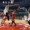 Photo - Washington Wizards power forward Nene (42) deflects a pass from Chicago Bulls center Joakim Noah (13) intended for Carlos Boozer (5) during the first half of an NBA basketball game, Monday, Jan. 13, 2014, in Chicago. (AP Photo/Charles Rex Arbogast)