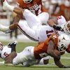 Oklahoma\'s Travis Lewis brings down Texas\' Fozzy Whittaker (2) during the Red River Rivalry college football game between the University of Oklahoma Sooners (OU) and the University of Texas Longhorns (UT) at the Cotton Bowl in Dallas, Saturday, Oct. 8, 2011. Photo by Bryan Terry, The Oklahoman
