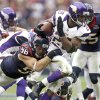 Photo - Minnesota Vikings running back Adrian Peterson (28) tries to turn upfield as Houston Texans' Connor Barwin (98) tackles him during the second quarter of an NFL football game Sunday, Dec. 23, 2012, in Houston. (AP Photo/Patric Schneider)