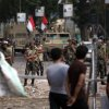 Supporters of ousted President Mohammed Morsi protest as army soldiers guard at the Republican Guard building in Nasr City, Cairo, Egypt, Tuesday, July 9, 2013. Egyptian security forces killed dozens of supporters of Egypt\'s ousted president in one of the deadliest single episodes of violence in more than two and a half years of turmoil. The toppled leader\'s Muslim Brotherhood called for an uprising, accusing troops of gunning down protesters, while the military blamed armed Islamists for provoking its forces. (AP Photo/Khalil Hamra)