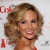 FILE - In this Feb. 11, 2010 file photo, television personality Elisabeth arrives at The Heart Truth\'s Red Dress Collection 2010 fashion show in New York. Hasselbeck is staying put as a co-host of