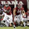 Photo - Alabama running back T.J. Yeldon (4) breaks for a 68-yard touchdown in the third quarter against Mississippi in an NCAA college football game in Tuscaloosa, Ala., Saturday, Sept. 28, 2013. (AP Photo/Tuscaloosa News, Dusty Compton)