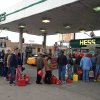 Shortly before the gas ran out, customers wait in line at a Hess station where the line of cars snaked 10 blocks, and at least 60 people waited to fill red gas cans for their generators, in the Gowanus section of Brooklyn, New York, Friday morning, Nov. 2, 2012. Courier Winston Alfred said he had been there in his van since 4:20 am, and was second in line, when he was turned away four hours later. (AP Photo/David Caruso)