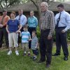 Patricia, front left, and Robert Hauser, front right, stand with their grandchildren, Cole Hakken, 4, second from left, and Chase, 2, with Hillsborough County Sherrif\'s investigators behind them, during a news conference outside the Hauser home in Tampa, Fla., Thursday, April 11, 2013. The two children were returned to the grandparents after their father, Joshua Hakken, forcibly kidnapped the children and sailed with them to Cuba. (AP Photo/Phelan M. Ebenhack)