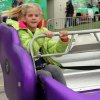 Carol Brothers, nine, of El Reno rides one of the rides at the carnival during the Czech Festival Saturday in Yukon. Photo by Hugh Scott, for the Oklahoman