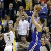 Photo - Golden State Warriors' Klay Thompson (11) puts up the game winning shot against Indiana Pacers' George Hill (3) during the second half of an NBA basketball game Tuesday, March 4, 2014, in Indianapolis. Golden State defeated Indiana 98-96. (AP Photo/Darron Cummings)