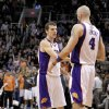 Phoenix Suns\' Marcin Gortat (4), of Poland, greets teammate Goran Dragic, of Slovenia, after Dragic made the game-winning shot against the Memphis Grizzlies during the second half of an NBA basketball game on Wednesday, Dec. 12, 2012, in Phoenix. The Suns won 82-80. (AP Photo/Matt York)