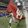 Photo - University of Oklahoma defensive back Lendy Holmes (11) carries the OU flag after the team beat University of Missouri 38-17 in the Big 12 Conference championship college football game, Saturday, Dec. 1, 2007, in San Antonio. (AP Photo/Eric Gay) ORG XMIT: SAD126