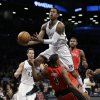 Brooklyn Nets\' MarShon Brooks collides with Toronto Raptors guard Kyle Lowry (3) as Lowry draws a foul by Brooks in the first half of an NBA basketball game Tuesday, Jan. 15, 2013, in New York. (AP Photo/Kathy Willens)
