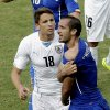 Italy\'s Giorgio Chiellini, right, shows his shoulder after colliding with Uruguay\'s Luis Suarez\'s mouth as Uruguay\'s Gaston Ramirez (18) watches during the group D World Cup soccer match between Italy and Uruguay at the Arena das Dunas in Natal, Brazil, Tuesday, June 24, 2014. (AP Photo/Hassan Ammar)