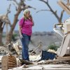 Penny Phillips talks on her phone as she tries to begin the clean up process with her home on Tuesday, May 21, 2013 in Moore, Okla. that was destroyed by Monday\'s tornado in the area near 4th and Bryant. Photo by Chris Landsberger, The Oklahoman