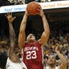 Photo - UNIVERSITY OF OKLAHOMA, OU: Oklahoma's Blake Griffin, center, shoots between Missouri's DeMarre Carroll, left, and Keith Ramsey, right, during the first half of an NCAA college basketball game Wednesday, March 4, 2009, in Columbia, Mo. (AP Photo/L.G. Patterson) ORG XMIT: MOLG103