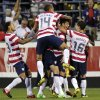 Photo -   United States players celebrate a goal by Herculez Gomez against Jamaica during the second half of a World Cup qualifying soccer match, Tuesday, Sept. 11, 2012, in Columbus, Ohio. The United States won 1-0. (AP Photo/Jay LaPrete)