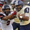 Southmoore\'s Pierce Speed fights off Westmoore\'s Cassius Hill during their high school football game in Moore, Okla., Friday, Sept. 13, 2013. Photo by Bryan Terry, The Oklahoman