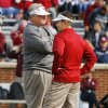 Texas A&M head coach Mike Sherman (left) and Sooner head coach Bob Stoops talk before the college football game between the Texas A&M Aggies and the University of Oklahoma Sooners (OU) at Gaylord Family-Oklahoma Memorial Stadium on Saturday, Nov. 5, 2011, in Norman, Okla. Photo by Steve Sisney, The Oklahoman