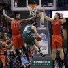 Milwaukee Bucks\' J.J. Redick (5) drives against Toronto Raptors\' Amir Johnson (15) and Andrea Bargnani (7) during the first half of an NBA basketball game Saturday, March 2, 2013, in Milwaukee. (AP Photo/Jeffrey Phelps)