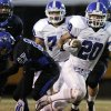 Photo - Deer Creek's Brennan Miyake, right, gets past the Southeast defense during a 2011 game at C.B. Speegle Stadium. The Antlers plan to utilize Miyake more in the passing game this season. Photo from The Oklahoman Archives