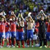 Photo - Costa Rica players greet supporters after the group D World Cup soccer match between Costa Rica and England at the Mineirao Stadium in Belo Horizonte, Brazil, Tuesday, June 24, 2014. Costa Rica has finished first in what many considered the World Cup's toughest group after a 0-0 draw against a second-string England side. (AP Photo/Fernando Vergara)
