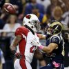 St. Louis Rams wide receiver Danny Amendola, right, catches a 44-yard pass as Arizona Cardinals cornerback Patrick Peterson defends during the first quarter of an NFL football game, Thursday, Oct. 4, 2012, in St. Louis. (AP Photo/Jeff Roberson)