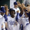 Photo - ADVANCE FOR WEEKEND EDITIONS, AUG. 30-31 - FILE - In this Aug. 27, 2014, file photo, Kansas City Royals' Lorenzo Cain celebrates in the dugout after scoring on a bunt single by Jarrod Dyson during the eighth inning of a baseball game against the Minnesota Twins in Kansas City, Mo. The recipe for small-market success goes something like this: Develop your own talent, succeed with a couple of reclamation projects, find a few diamonds in the rough and make one or two big trades to put your over the top. The Royals have followed that process exactly, and that's why the franchise is staring down its first playoff appearance in nearly 30 years.  (AP Photo/Charlie Riedel, File)