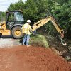 Edmond city workers attempt to rebuild the lost shoulder of Coffee Creek Rd. between Kelly and Santa Fe in Edmond, OK, after yesterday\'s torential rains. Tuesday, June 15, 2010. By Paul Hellstern, The Oklahoman