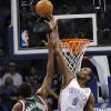 Oklahoma City\'s Serge Ibaka (9) blocks a shot by Milwaukee \'s Luc Richard Mbah a Moute (12) during the season finally NBA basketball game between the Oklahoma City Thunder and the Milwaukee Bucks at Chesapeake Energy Arena on Wednesday, April 17, 2013, in Oklahoma City, Okla. Photo by Chris Landsberger, The Oklahoman