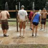 Participants wash off mud during the MUDD (Mankind United to Destroy Dystrophy) Volleyball Tournament to benefit the Muscular Dystrophy Association, in Mustang, Okla., Saturday, July 19, 2014. Photo by Nate Billings, The Oklahoman